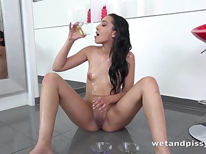 Tiny tits solo girl pours piss 'round over herself