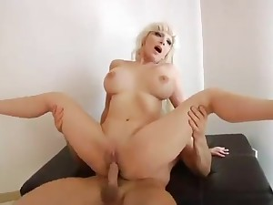 A blond hair lady mature with giant natural cans rides penis
